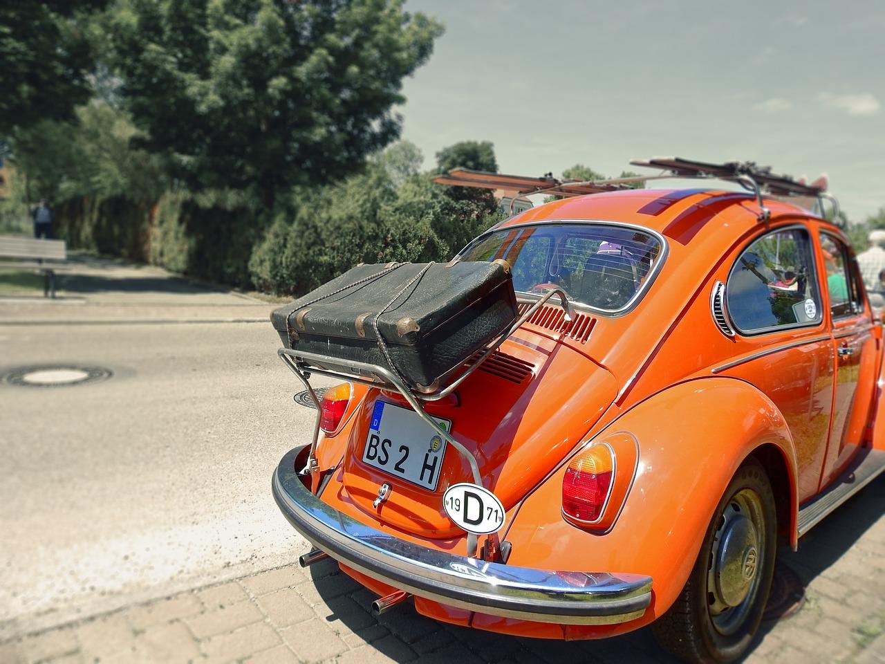 voiture orange bagages vacances voyage